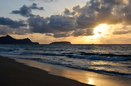 Sunset on the island of Porto Santo, view from the sandy beach of the Atlantic Ocean, Portugal