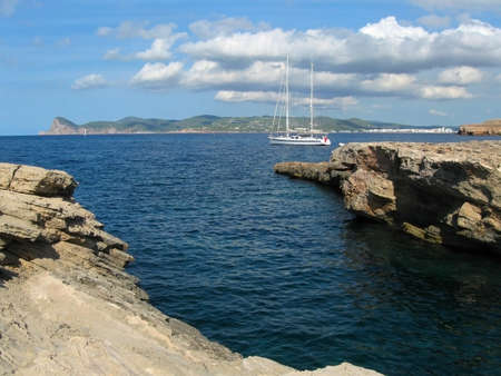 The yacht is at anchor near the shores of Ibiza, Spain Фото со стока