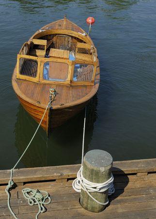 docked: Small boat docked in Oslo, Norway Stock Photo