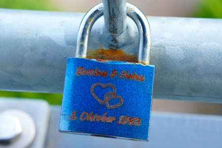 Blue love lock on a railing
