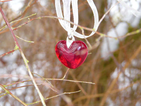 Red heart with ribbon shows lonely times