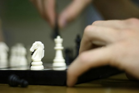 strategical: Strategic games; chess; white knight on chess board
