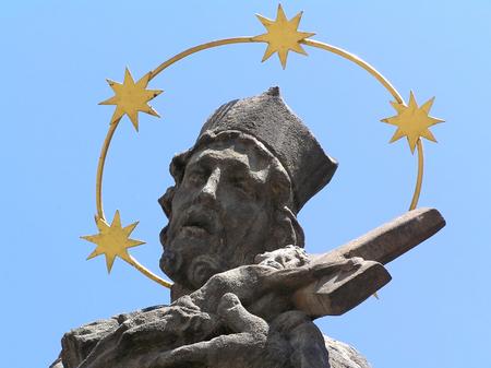 aureola: Statue of a saint on pest pole in Pardubice in Czech republic Stock Photo