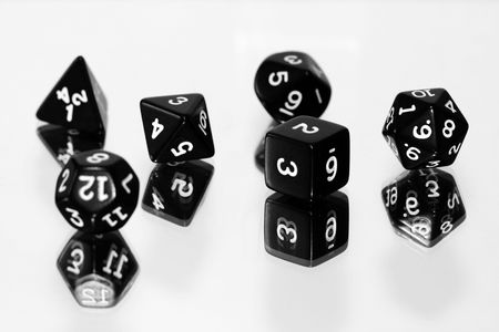 octahedral: Black dice on white background - shallow depth of field
