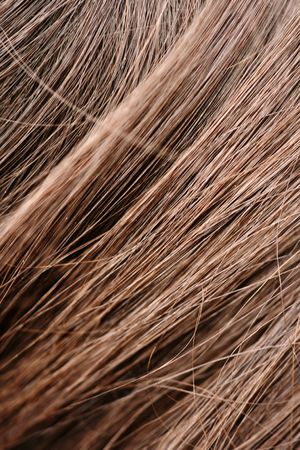 Close-up of beautiful sharp brunet hair