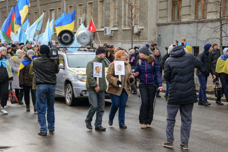 temporarily: KYIV, UKRAINE - FEBRUARY 26, 2017: On the streets of the city is a march of solidarity in support of the Crimean Tatars, Ukrainians and people of other nationalities who reside in a temporarily occupied Crimea and preserve their own dignity and loyalty to Editorial