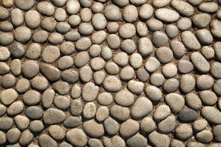 Texture of stone and pebbles and concrete wall