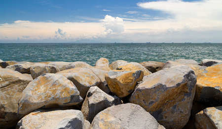 Breakwater stones at the seaside in Manila Bay, Philippines