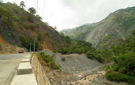 A dangerous road in a mountainous steep area in Baguio, Philippines Stock Photo