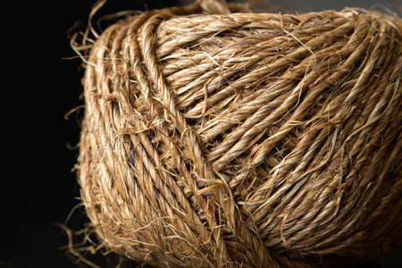 Skein of jute twine on black background, close up, macro Imagens