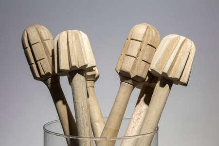 Wooden mashers in glass, close up, macro Reklamní fotografie