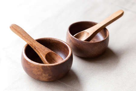 Wooden utensils on white background, from above Imagens