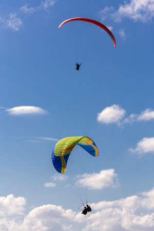 Two parachutes gliding in the sky