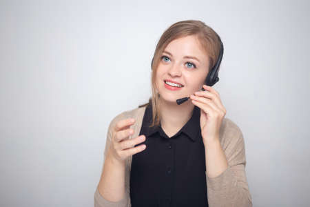 Young caucasian woman is talking on the headset phone in a call center Stock fotó