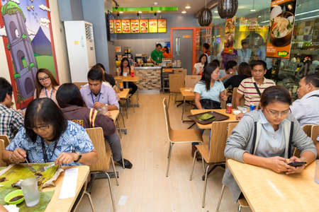 Manila, Philippines - July, 26, 2016: People eating lunch in a popular filipino fast food chain