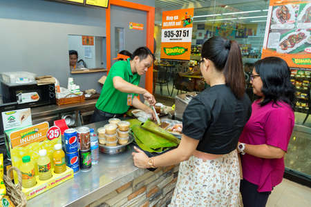 Manila, Philippines - July 26, 2016: Two female customers ordering food at the cashier in a filipino reastaurant