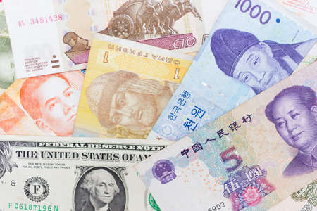Money banknotes of different countries or currency exchanging background