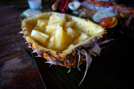 Filipino authentic traditional dish: philippine stuffed pinapple on a table, closeup