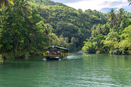 Bohol, Philippines - June, 20, 2019: Floating buffet reastaurant cruise on Loboc River Imagens