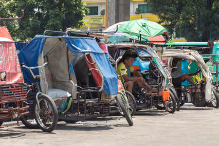 Manila, Philippines - September, 6, 2016: Philippine tricycles on the street