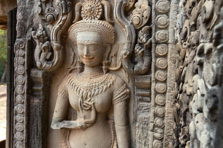 Mural of the woman Apsara on wall Angkor Wat temple complex, close up