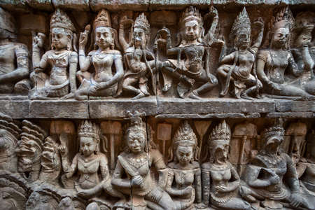 Carved bas-relief design murals on a temple at Angkor Wat complex, Cambodia, closeup