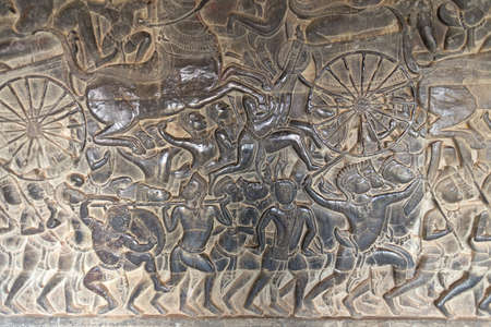 Bas Relief mural of Khmer culture in Angkor Wat temple wall , Cambodia, close up Imagens