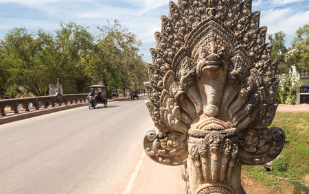 The perspective of an old angkor bridge road with stone statue in Siem Reap, Cambodia Фото со стока