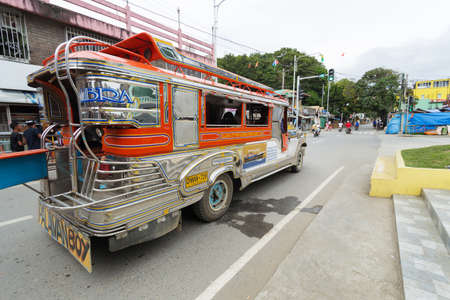 Puerto Galera, Philippines - January 9, 2017: Jeepney staying to pick up passengers, crossroad, day time