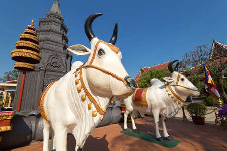 SIem Reap, Cambodia - February 1, 2017: Sculptures of sacred cows in Buddhist Temple Wat Preah Prom Rath