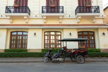 Siem Reap, Cambodia - February 2, 2017: Traffic in cambodian roads, tuktuks with tourists Редакционное