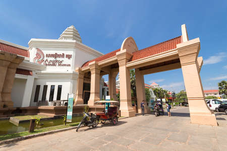 Siem Reap, Cambodia - February 2, 2017: Angkor national museum entrance with tuktuks Editorial