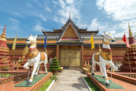 Siem Reap, Cambodia - February 2, 2017: Statues of horses in buddhist temple Preah Prom Rath