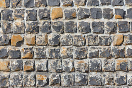 Texture background of concrete grey and brown stone rock wall or pavement