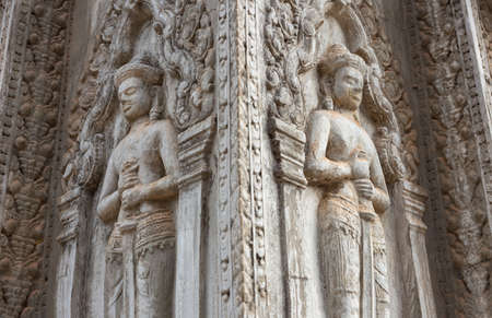 Bas Relief mural of Khmer culture in Angkor Wat temple wall , Cambodia, close up 스톡 콘텐츠