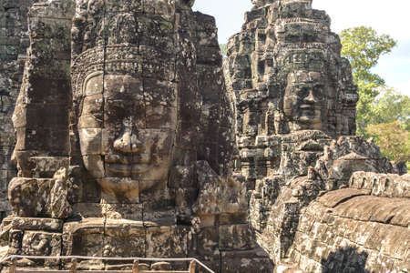 Faces carved in stone in Bayon temple towers, Angkor Wat complex, Cambodia, Siem Reap
