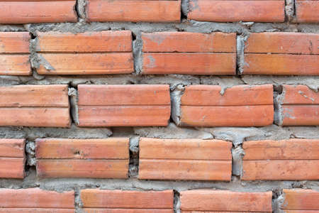 Texture of red brick and cement wall, close up 스톡 콘텐츠