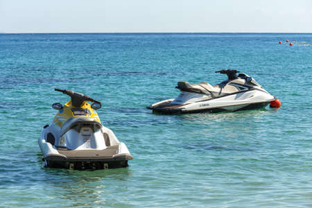 Puerto Gallera, Sabang, Philippines - April 4, 2017: Two jet ski in the sea. Water activities on White beach 에디토리얼