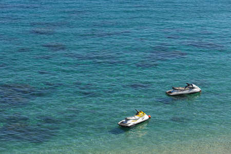 Puerto Galera, Sabang, Philippines - April 4, 2017: Two jet ski in the sea. Water activities on White beach 에디토리얼