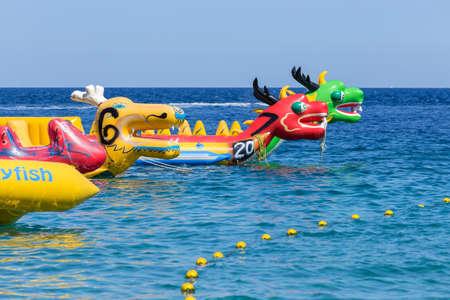 Puerto Galera, Sabang, Philippines - April 4, 2017:  Inflatable attractions, banana dragon boats near White beach