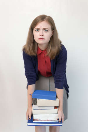 Young caucasian girl woman with many books study at school or university, or teacher