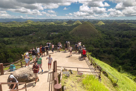 Bohol, Philippines - January, 27, 2020: Many people tourists visit Chocolate Hills