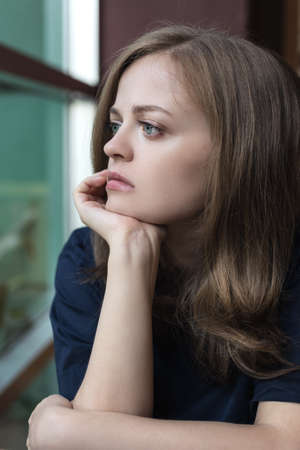 Crying young caucasian woman girl looks sad, depressed, upset or unhappy Stock Photo