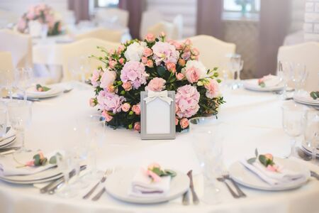 Guest table, with bouquet from petals and a number Stock Photo