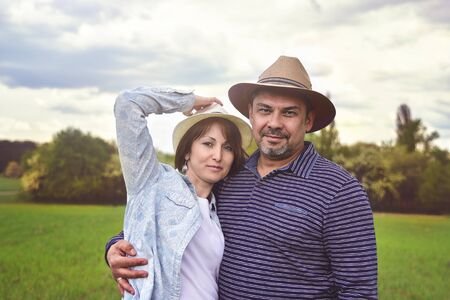 photo portrait of a happy middle-aged couple in nature, love concept