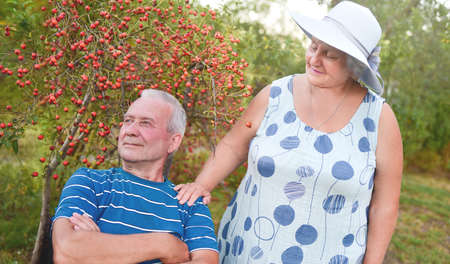 Happy senior couple enjoying each other in the park. Support and care from a loved one, warm emotions Stockfoto