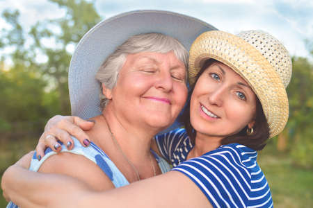 Happy daughter embracing her smiling mother.