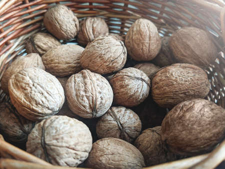 A group of walnuts in a wooden basket. Healthy eating lifestyle