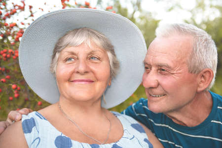 Authentic outdoor shot of aging couple having fun in the garden and blessed with love. love concept