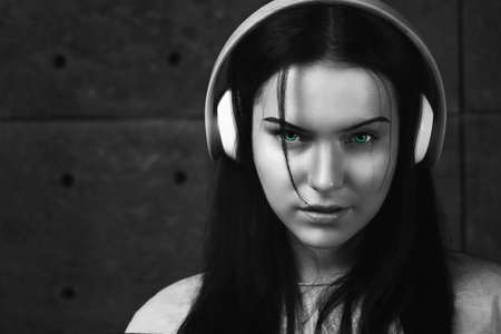 Sexy brunette with the headphones